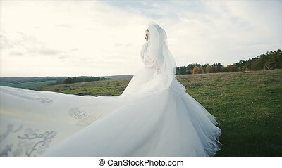 Bride's bridal veil blowing in the wind - Bride's bridal...