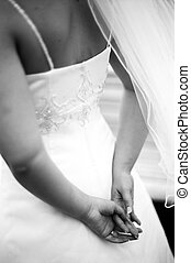 Bride's dress - Detail of bride's dress and hands