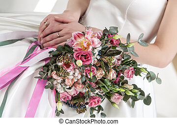 Bride's Hands And Bouquet Of Flowers