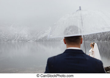 brides mountain near the lake in winter. Tender couple in love.
