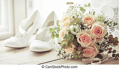 Brides shoes and wedding bouquet