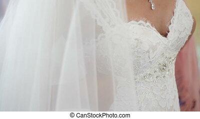 Brides wear a necklace around neck