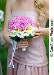 bridesmaid holding a beautiful wedding bouquet