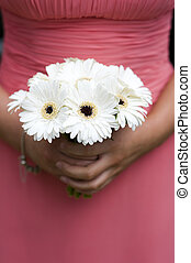 bridesmaid holding a bouquet of berbera
