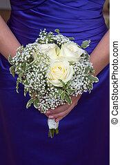 bridesmaid holding a wedding bouquet