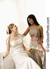 Bridesmaid holding bride\'s veil. - Indian maid of honor...