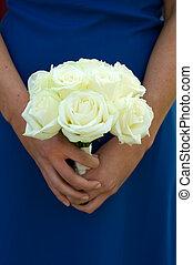 bridesmaid holding white rose wedding bouquet