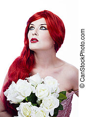 Bridesmaid with red hair holding a bouquet of white roses