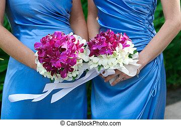 Bridesmaids. - Close-up of bridesmaids holding wedding...