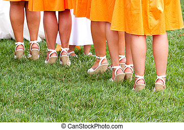 Bridesmaid\'s Feet - A photo of the feet and legs of...