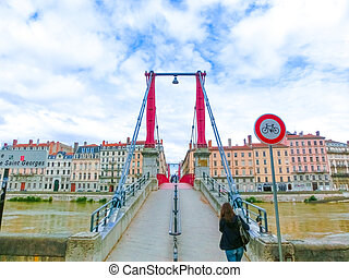 Bridge across river Rhone on winter sunny day, Lyon, France