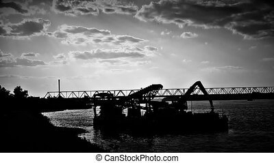 Bridge and barge in the dark