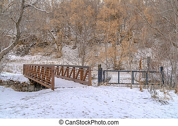 Bridge and fence on a mountain covered with snow