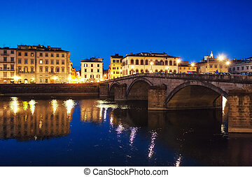Bridge and house in the evening on the waterfront of Florence