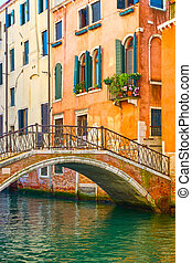 Bridge and old houses by canal in Venice