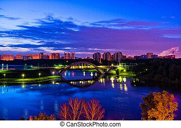 Bridge and skyline at night - Photo of bridge and skyline at...