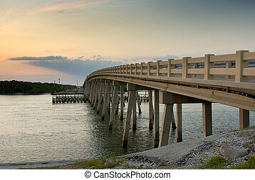 bridge arching over bay - a cement bridge arches over the...