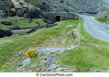 Road in the valley on the narrow part of Gap of Dunloe, Ireland