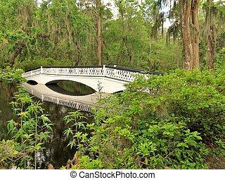 White iconic bridge at the Magnolia Plantation