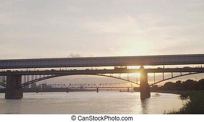 Bridge at sunset, lake in Russia.