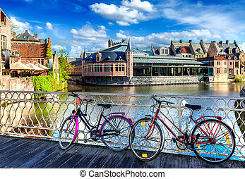 Bridge, bicycles and canal. Ghent, Belghium - Bicycle is...
