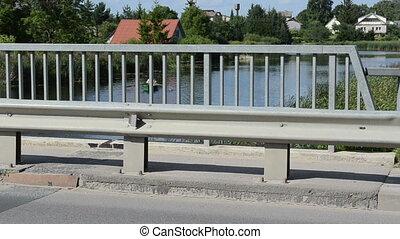 bridge car boat man