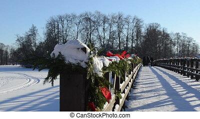 bridge christmas people - closeup of wooden lake bridge with...