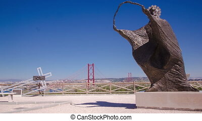 bridge connecting the city of Lisbon to the municipality of Almada trom viewpoint with statue, Lisbon timelapse