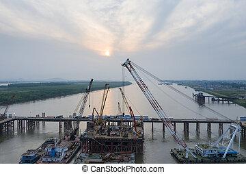 bridge construction site at dusk