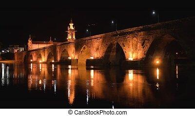 Bridge crossing the Rio Lima at night - Night view of Roman...