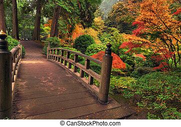 Bridge in autumn - Historic wooden bridge in a park ...