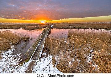 Bridge in snowy Winter landscape