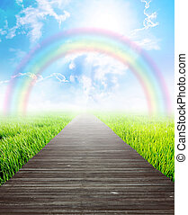 Bridge in summer landscape with rainbow