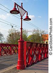 Bridge in Wroclaw with old metal lantern, Poland