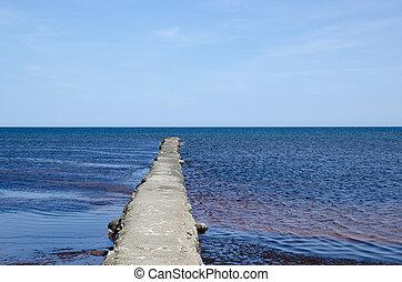 Bridge into blue water
