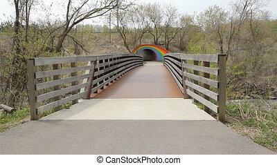 Bridge leads to Rainbow tunnel. - Pedestrian bridge leads to...