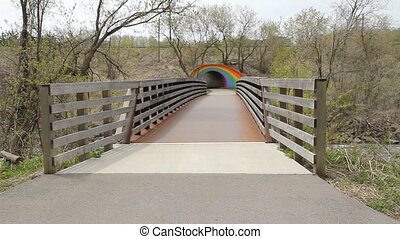 Bridge leads to Rainbow tunnel. - Pedestrian bridge leads to...