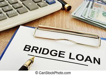 Bridge loan form and clipboard on a desk.