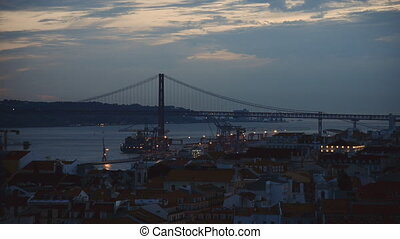 Bridge of 25th april in Lisbon at evening.