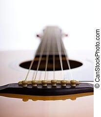 Bridge of acoustic guitar against light