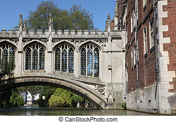 The Bridge of Sighs in Cambridge is a covered bridge and was built in 1831 and crosses the River Cam between the St John college's Third Court and New Court. This image taken from a Punt on the river Cam.