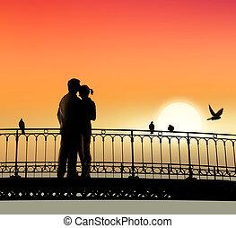 bridge of sweethearts - silhouette of bridge and pair of...