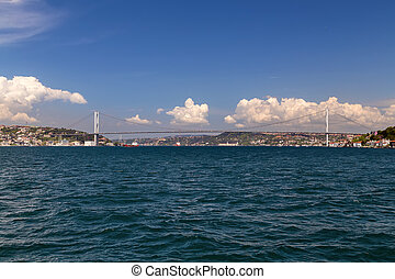 bridge on Bosphorus connecting the european waterside of Istanbul with the asian waterside on background of blue sky