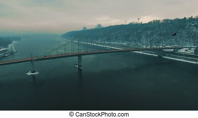 Bridge on city.Pedestrian bridge in the foggy winter day.Aerial drone footage