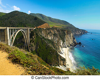 Bridge on Pacific rocky coast of California