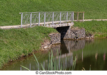 bridge on the lake in the park