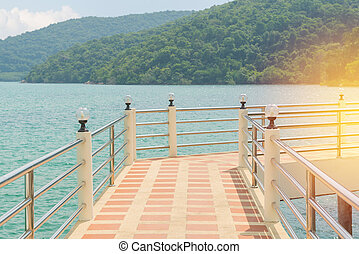 Bridge on the sea with mountain blue sky