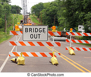 Bridge out sign on a road barricade