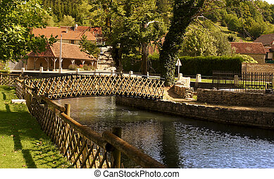 Bridge over a canal in the medieval town of Quincerot in Bourgog