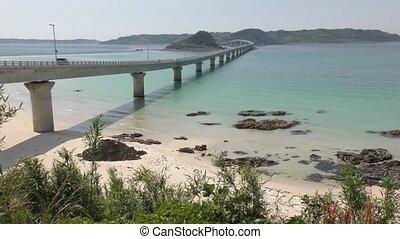 Bridge over blue green sea - Tsunoshima Ohashi bridge over...